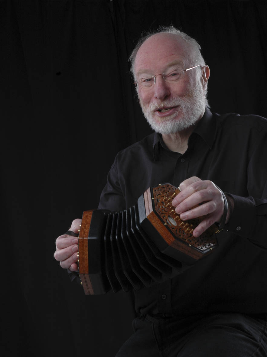 Image of Mike singing and playing concertina.